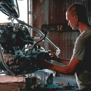 Mechanic building a motorcycle engine